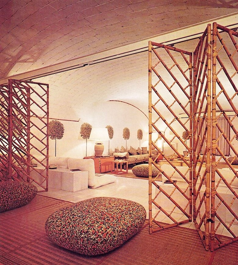 Currently coveting: 1970's modern white space age decor paired with rattan and leather. Especially and specifically this rattan room divider ON A TRACK in Valentino's NY Apartment, from The NYT Book of Interior Design and Decoration © 1976