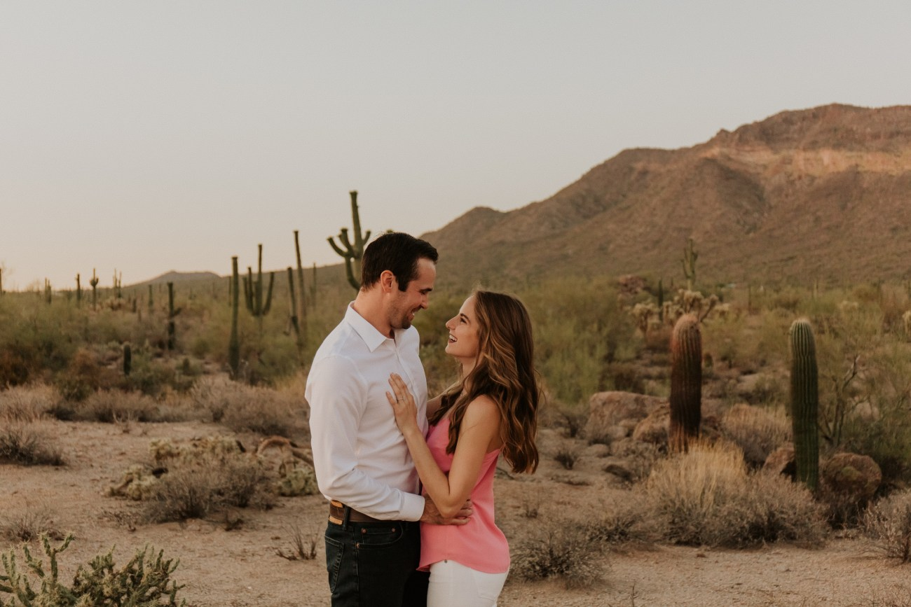 Megan Claire Photography | Arizona Wedding Photographer. Desert engagement photoshoot in front of mountains. @meganclairephoto