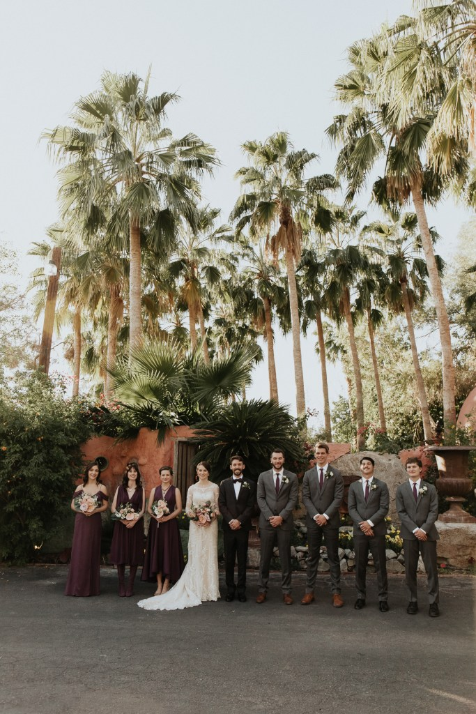 Megan Claire Photography | Arizona Wedding Photographer. Vintage inspired greenhouse arboretum wedding. Bridal party in purple and black @meganclairephoto