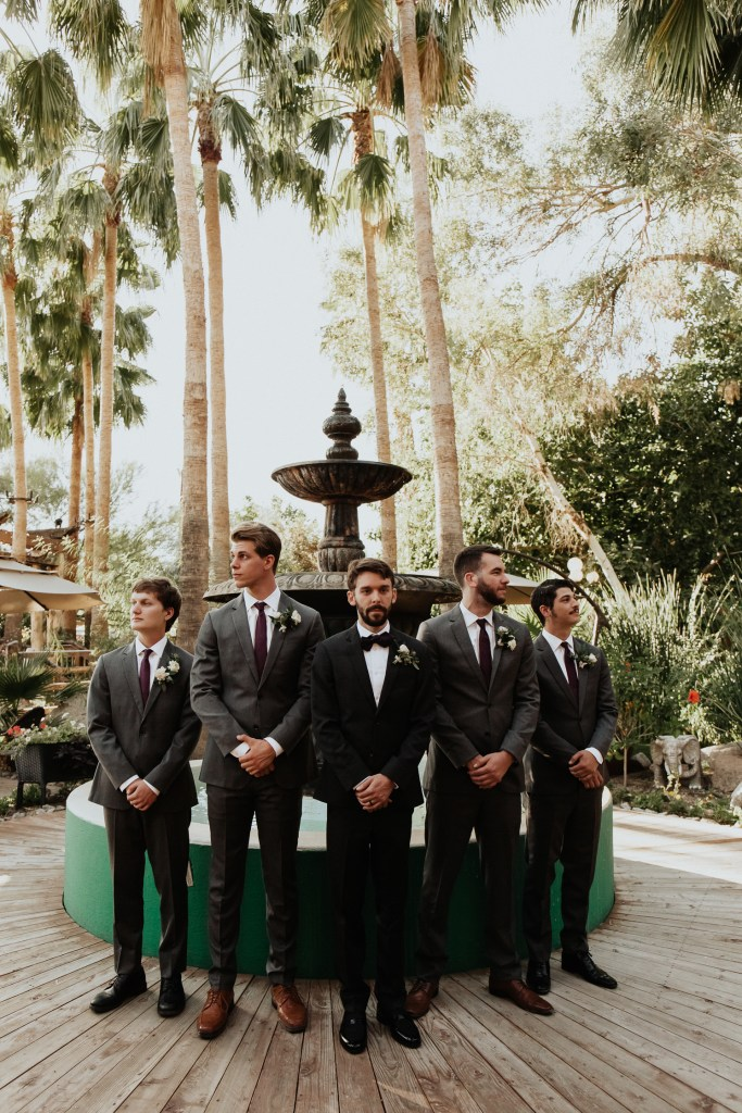 Megan Claire Photography | Arizona Wedding Photographer. Vintage inspired greenhouse arboretum wedding. Groomsmen in gray suits and purple ties, groom wearing tux @meganclairephoto