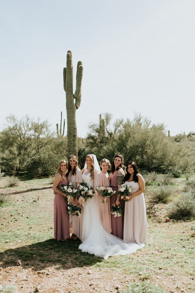Megan Claire Photography | Arizona Wedding Photographer. Beautiful winter wedding in the desert at the Paseo in Apache Junction, Arizona near superstition mountains. Bridal party photos, bridesmaids in blush, mauve, and purple