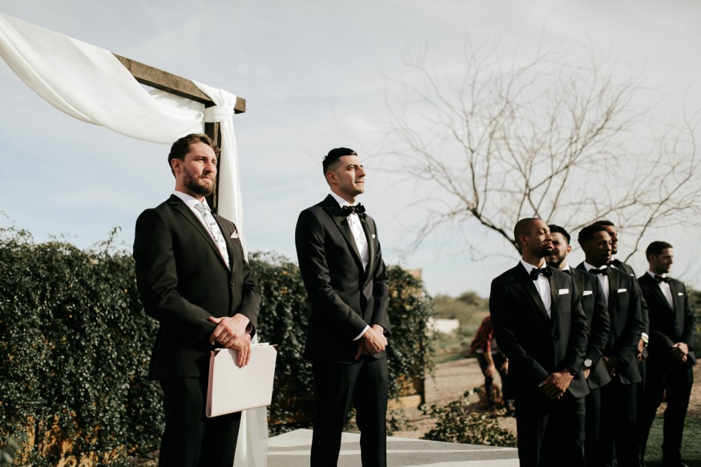 Megan Claire Photography | Arizona Wedding Photographer. Beautiful winter wedding in the desert at the Paseo in Apache Junction, Arizona near superstition mountains. Outdoor wedding ceremony in the desert with mountain views