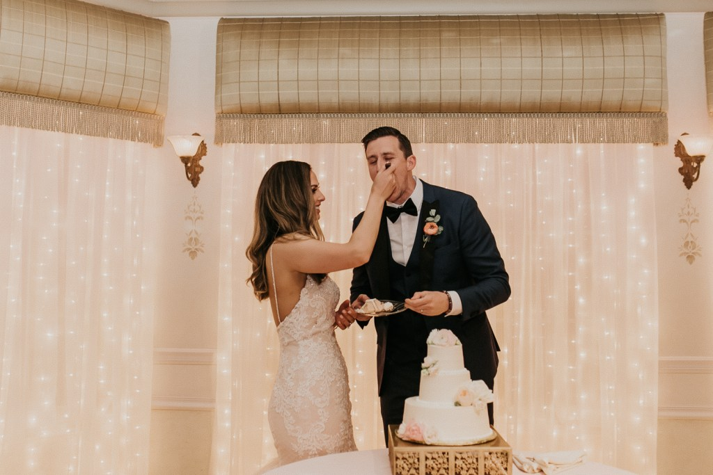 Megan Claire Photography | Arizona Wedding Photographer. Beautiful summer wedding in the desert at the Wright House in Mesa, Arizona. Bride and groom cutting wedding cake