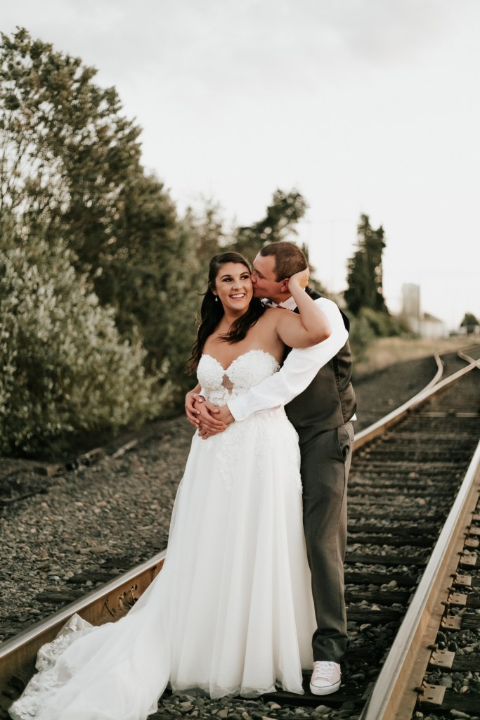 Megan Claire Photography | Arizona Wedding Photographer | Megan-Claire.com | Beautiful summer wedding in Portland, Oregon. Summer forest wedding inspiration. Bride and groom portraits on train tracks