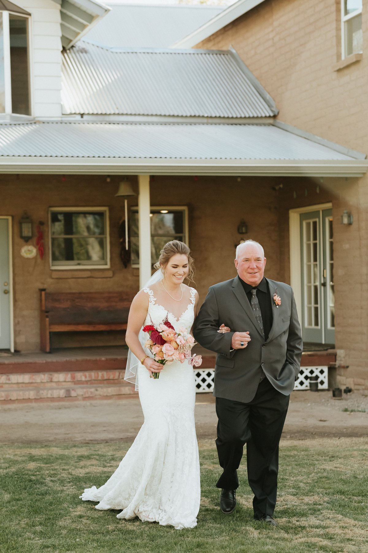 Megan Claire Photography | Arizona Elopement and Intimate Wedding Photographer.  Faith filled elopement at St. Ann's Chapel in Tucson, Arizona. Bride walking down the aisle