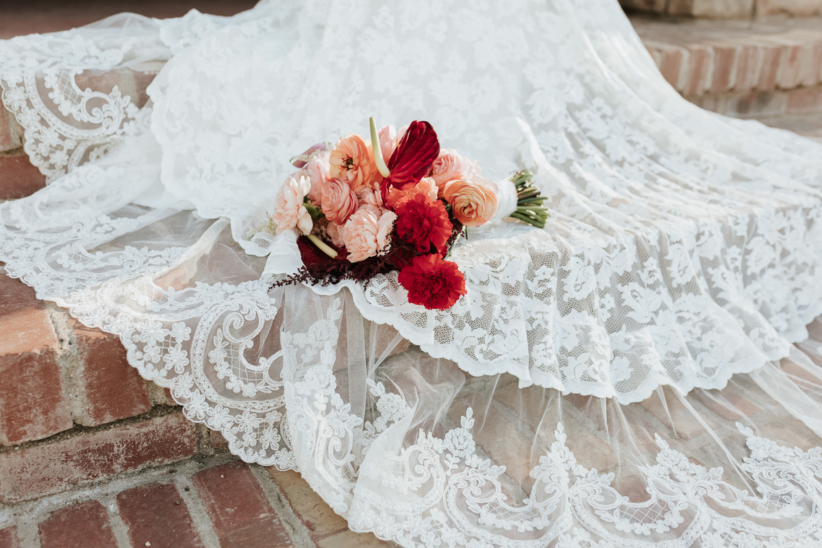 Megan Claire Photography | Arizona Elopement and Intimate Wedding Photographer.  Faith filled elopement at St. Ann's Chapel in Tucson, Arizona. Winter wedding bouquet
