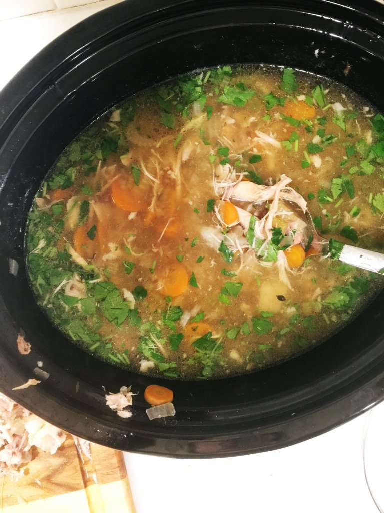 classic homemade chicken soup in a slow cooker