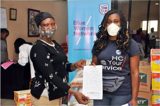 Stanbic IBTC female employees reach out to less privileged