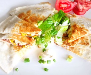 Easy re-fried bean quesadillas plated with the toppings