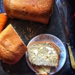 Easy Basic Vegan Bread shown slathered with Vegan butter