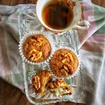 Banana nut muffins shown with a cup of tea