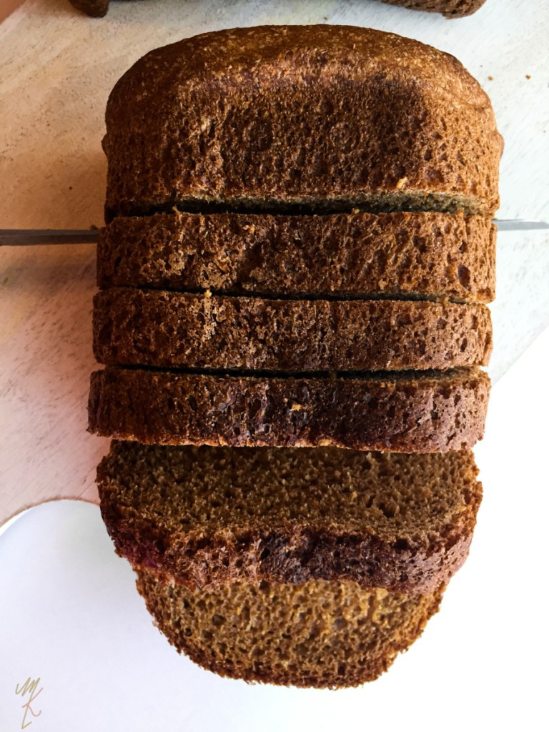 oil free whole wheat vegan bread shown on a white cutting board.