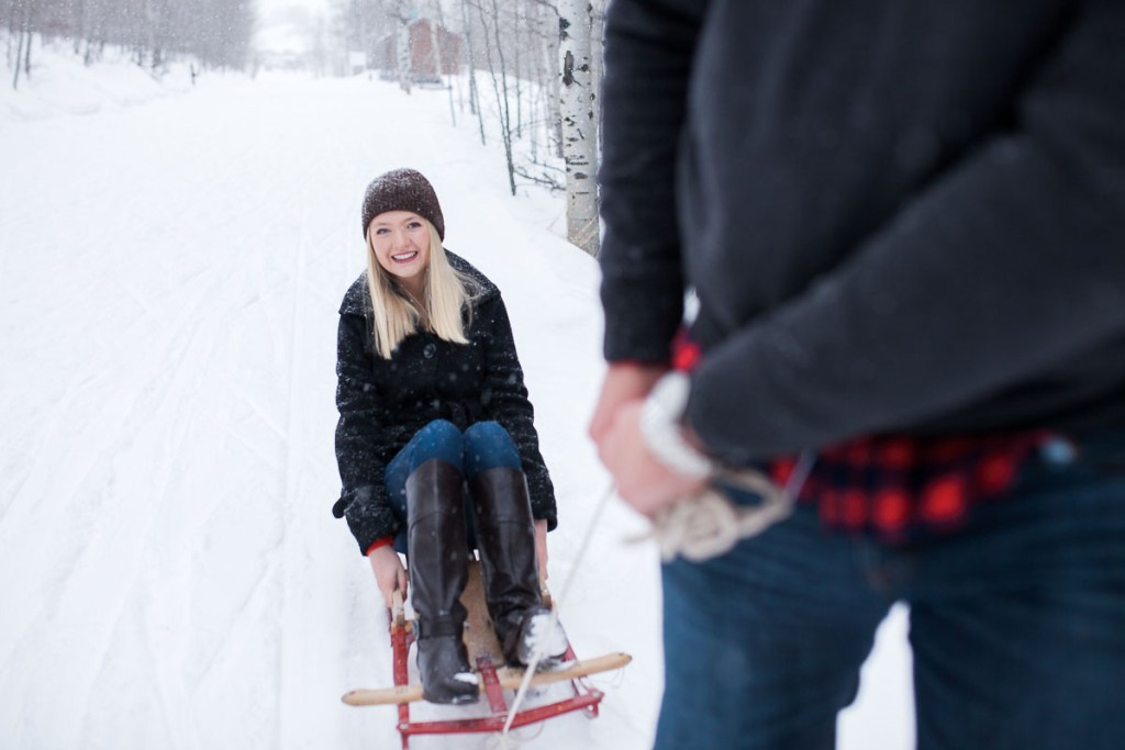 Fun engagement session on vintage sled