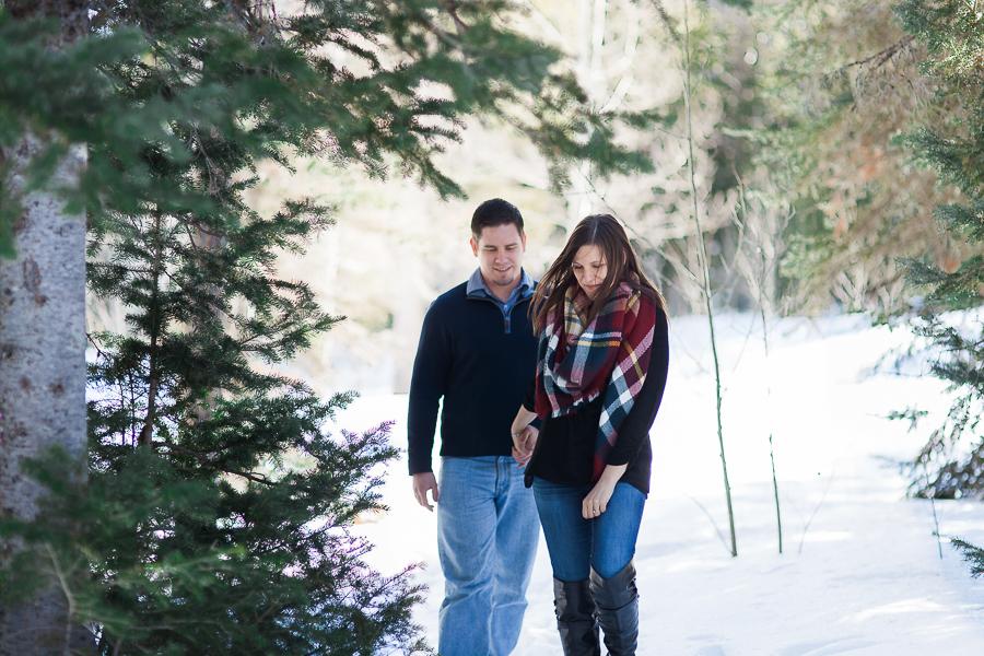 Engaged couple walking on a trail near Cheyenne Wyoming
