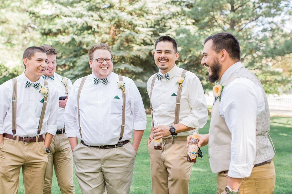 Devin and his groomsmen enjoy some drinks on the shaded lawn while they wait for things to get started.