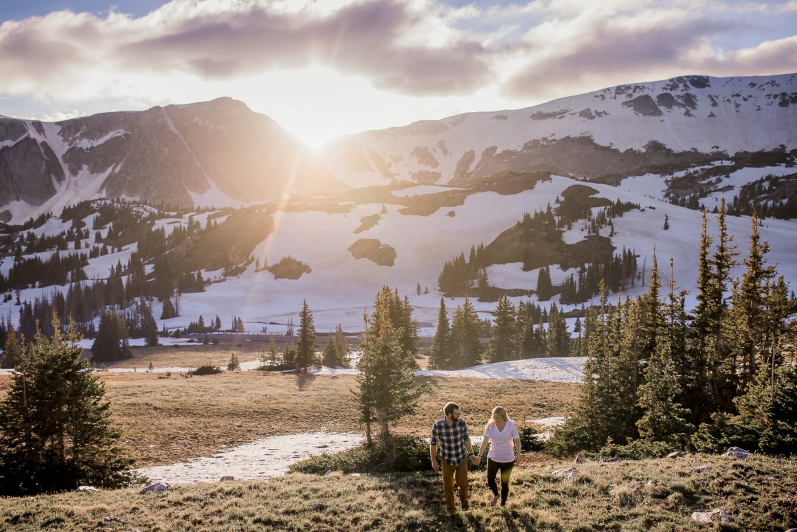 Engagement photography in the mountains of Wyoming by Laramie based photographer. Couple in snowy mountains