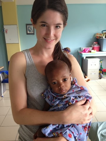My sister, Rachel, in Haiti with an abandoned baby.