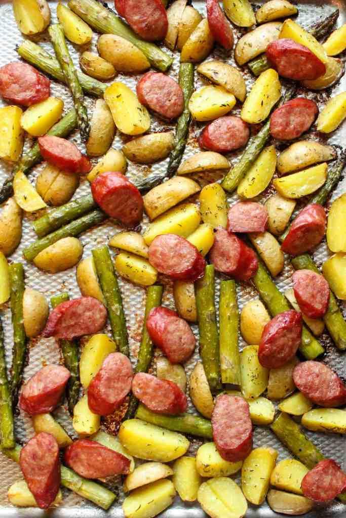 Sausage  and Potato on a baking sheet.