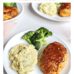Mini BBQ Chicken Meatloaves on a pink plate with a glass of water near by