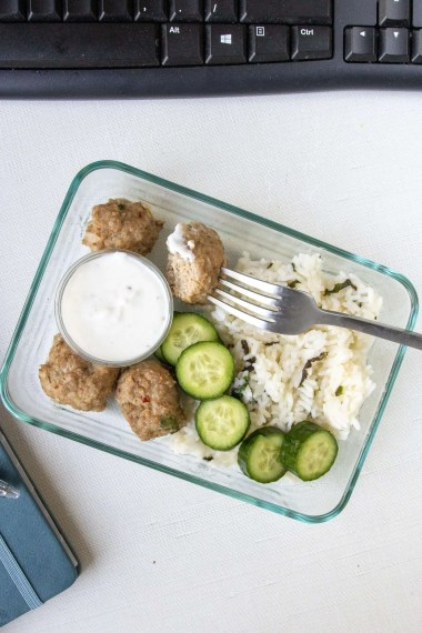 Greek Turkey Meatballs with Rice in a meal prep container