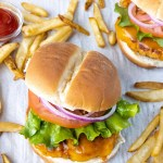 Ground Chicken Burgers on a try with French fries and ketchup.