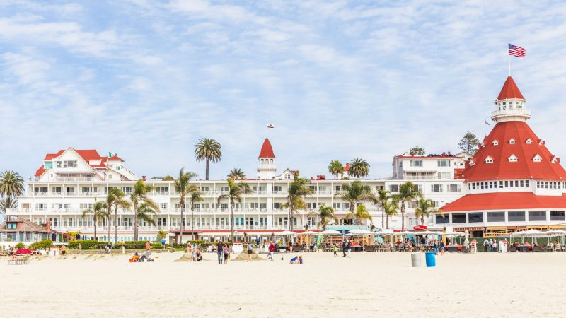 Horizontal landscape picture of the beach and Hotel del Coronado.