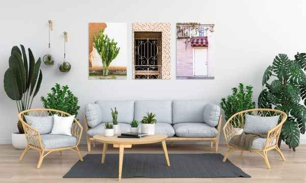 Three canvas prints hanging on the wall of a living room.