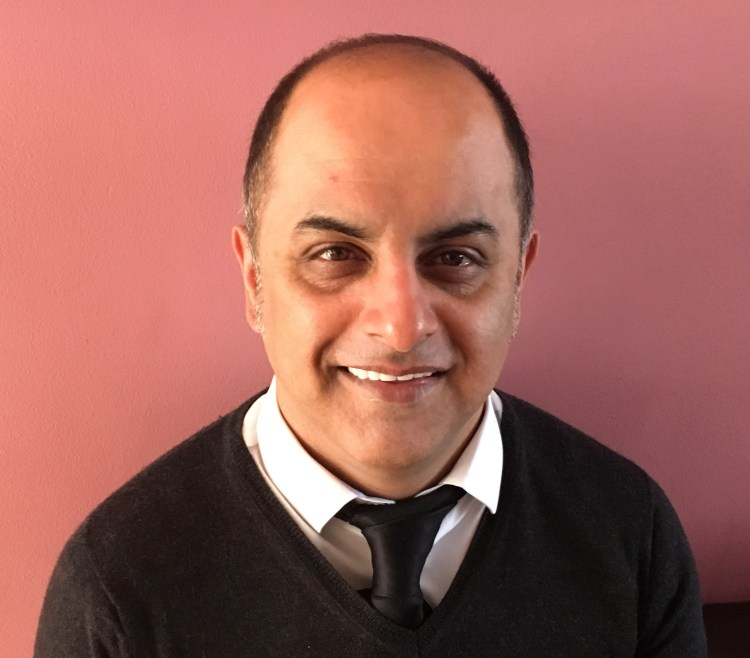 Author photo of Bali Rai, head and shoulders on pink background