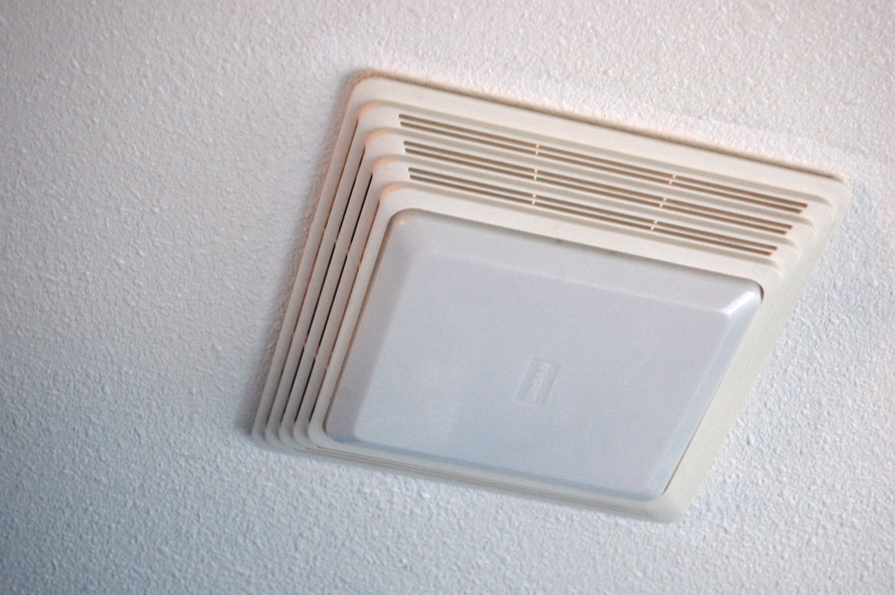 cleaning your bathroom fan with a