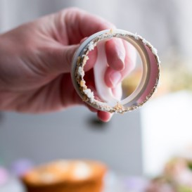 Homemade angel food cupcakes filled with strawberry limoncello compote & covered in 7-minute frosting are airy dreamy bites of heaven. | www.megiswell.com