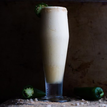 The classic rum painkiller cocktail is remixed as a Frozen Pineapple Painkiller Margarita with Ginger and Jalapeño. | www.megiswell.com