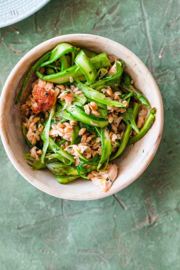 Overhead shot of Salmon Grain Bowl filled with farro, asparagus, and salmon.