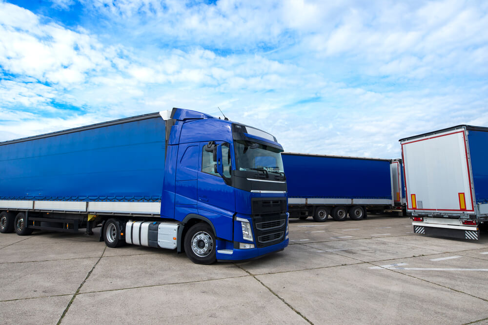 truck-vehicle-with-trailers-in-background (1)