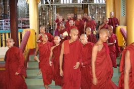 Monks leaving meditation
