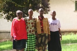 Young Masaii girls getting an education and saved from early marriages. The hair is always kept very short.