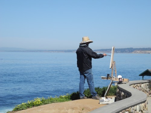 Artists dot the shore