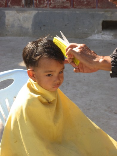 A haircut right in your own backyard, before school....