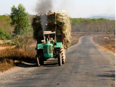 A Myanmar super highway out of town, circa 2008. For the few who own cars, gas is sold in quart bottles