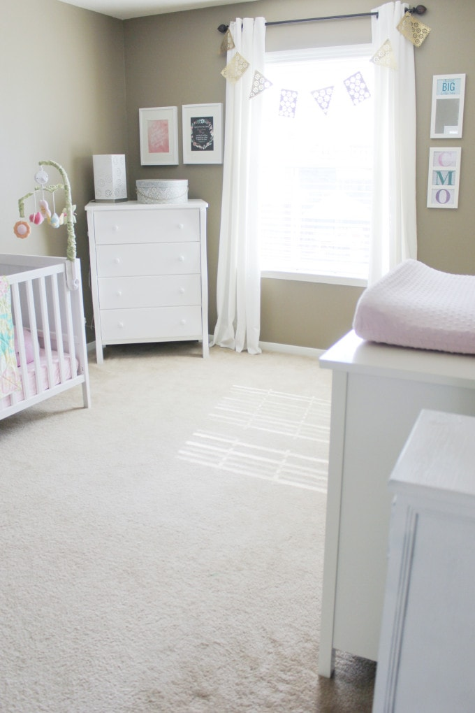 Neutral nursery with pops of color, ikea furniture, etsy quilt, pinterest prints, budget friendly