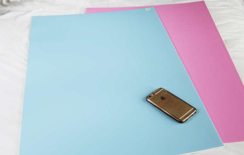 picked these colored foam boards up at Hobby Lobby and they are amazing to use as a photo background for product photography!