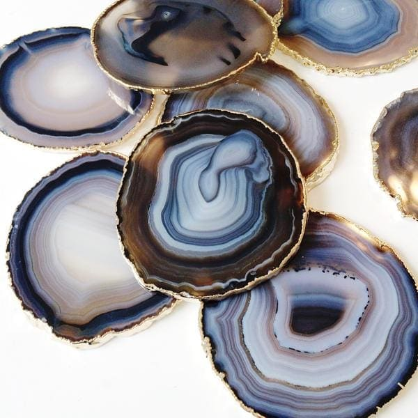 Manor Agate Coasters http://www.shopthemanor.com/collections/decor/products/agate-coasters-with-gold-leaf-trim-black-blue-brown-natural