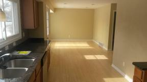 Standing into the kitchen looking into the living room area - before anything is moved in. I loved our bamboo floors