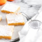 Classic Meyer Lemon Bars are a great option for Easter dessert. Simple to make with a great sweet, tart zing. Crumbly, sweet shortbread and tart meyer lemon filling.