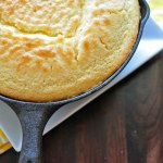 Sweet cornbread is baked in a cast iron skillet to produce a brown crispy bottom which is just perfect to accompany your favorite chili or soup.
