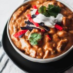 Chicken Enchilada Soup is a Chili's copycat and our favorite soup ever. Cheesy, spicy, creamy and filling.