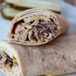 Cuban Wraps are a twist on a classic sandwich of roasted pork, deli ham, Swiss cheese, pickle & mustard. Made in the slow cooker for a simple weeknight meal