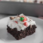 Leftover Halloween Candy Cake is the best way to use up all the kids Halloween candy. Some store-bought short cuts including a doctored up cake mix and 4 ingredient whipped frosting.