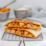 Meet your new craving, the Buffalo Chicken Crunch Wraps. Spicy buffalo chicken, mozzarella cheese, blue cheese and a crispy tostada shell all wrapped up in a soft flour tortilla and cooked to crispy perfection.