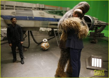 IVER HEATH, ENGLAND - APRIL 19: Prince William, Duke of Cambridge (R) is hugged by Chewbacca as British actor John Boyega smiles during a tour of the Star Wars sets at Pinewood studios on April 19, 2016 in Iver Heath, England. Prince William and Prince Harry are touring Pinewood studios to visit the production workshops and meet the creative teams working behind the scenes on the Star Wars films. (Photo by Adrian Dennis-WPA Pool/Getty IMages)