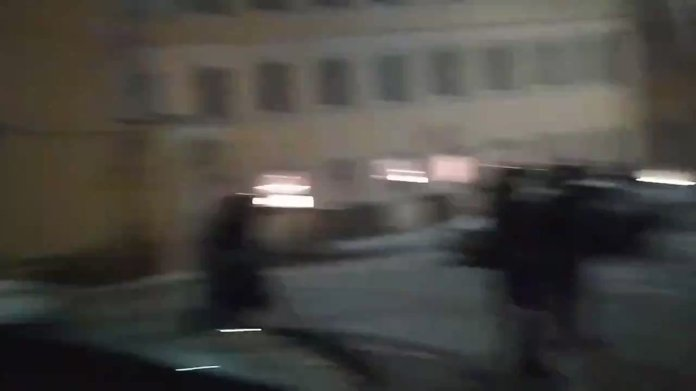 JUST IN - Riot police knock out a journalist in a press vest with a baton in #Moscow.